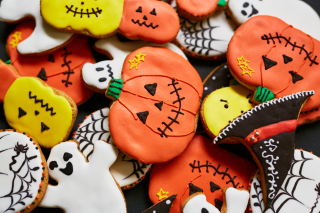 Storyblocks-trick-or-treat-cookies-in-form-of-pumpkin-ghost-and-hat_r9fRMKxgiZ