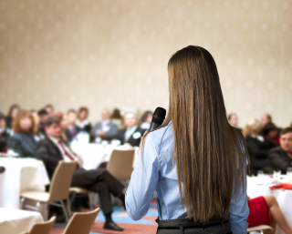 Graphicstock-beautiful-business-woman-is-speaking-on-conference_SCzbUdkibW