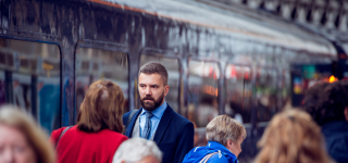 Graphicstock-hipster-businessman-walking-at-the-station-crowded-underground-platform-train_ru4GFpzBf-